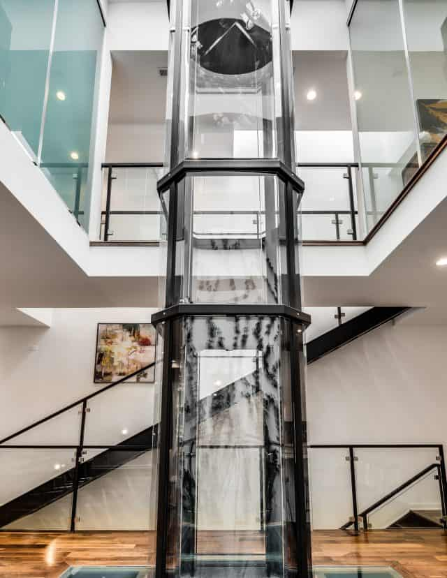 savaria vuelift octagonal glass elevator designed with stunning transparent glass hoistway and cab
