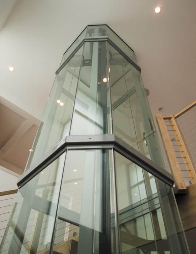 savaria vuelift octagonal glass elevator with glass hoistway and cab giving a panoramic view